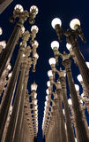LOS ANGELES, CA - April 25, 2016: 'Urban Light' is a large-scale assemblage sculpture by Chris Burden at the LACMA. LOS ANGELES, CA - April 25, 2016: 'Urban Royalty Free Stock Photo