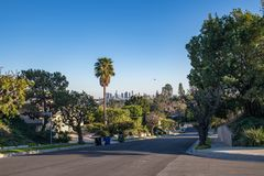 Los Angeles Residential Street with Downtown LA Skyline. Los Angeles, CA: February 16, 2018: A Los Angeles residential street with the Downtown Los Angeles Stock Photos