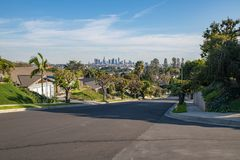 Los Angeles Residential Street with Downtown LA Skyline. Los Angeles, CA: February 16, 2018: A Los Angeles residential street with the Downtown Los Angeles Royalty Free Stock Photos