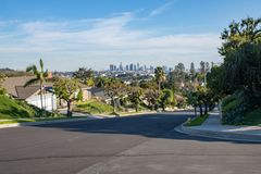 Los Angeles Residential Street with Downtown LA Skyline Royalty Free Stock Photography