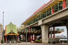 Chinatown metro station, Los Angeles California. Los Angeles, CA, USA - April 5, 2018: Escalator and stairway covered by Chinese-style roof leads into Chinatown Stock Photos
