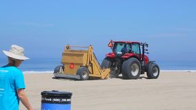Garbage collection on the beach in California. Los Angeles, California - April 2017: Garbage collection on the beach in California. Special equipment cleans sand stock video footage