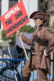 Repeal The 2nd Amendment sign People`s Rally Against Violence. LOS ANGELES, CALIFORNIA - FEBRUARY 19, 2018: `Repeal The 2nd Amendment` sign and Patriot at the Stock Photos