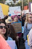 2nd Annual Women`s March - God Bless Everyone. LOS ANGELES, CALIFORNIA - JANUARY 21, 2018:  2nd Annual Women`s March marcher  holding sign that reads, `God bless Royalty Free Stock Image