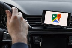 LOS ANGELES, CALIFORNIA - JUNE 6, 2019: Close up to male driving and using navigation appliction Google Maps. Get direction. An. Illustrative editorial image royalty free stock image