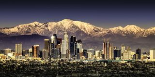 Los Angeles California with snow capped mountains royalty free stock photos