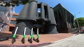 Google Binocular Building Venice. Los Angeles, California, United States - August 21, 2018: bird and lime electric scooters in front of Binocular Building Google