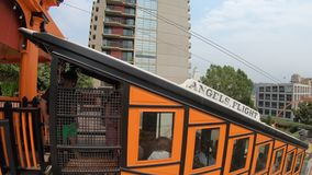 Angels Flight Los Angeles. Los Angeles, California, United States - August 9, 2018: tourists catching famous Angels Flight, funicular railway on Hill Street stock footage
