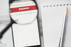 Los Angeles, California, USA - 3 April 2019: Equifax official website homepage under magnifying glass. Concept Equifax Credit risk stock images