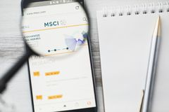 Los Angeles, California, USA - 3 April 2019: MSCI official website homepage under magnifying glass. Concept Morgan Stanley Capital. International logo visible royalty free stock photography