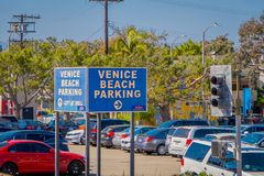 Los Angeles, California, USA, AUGUST, 20, 2018: Outdoor view of Venice Beach Parking area with some cars parked in Santa. Monica, the ocean, and parking lot royalty free stock photography