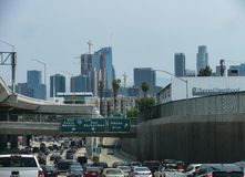 Traffic jam with view of LA skyscrapers and road signs royalty free stock image