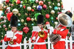 Christmas carols. LOS ANGELES, CALIFORNIA, USA, DECEMBER 23, 2006 - A group of musicians in costumes that remind us of the tale of the lead soldier play carols Royalty Free Stock Image