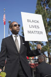 Los Angeles, California, USA, January 19, 2015, 30th annual Martin Luther King Jr. Kingdom Day Parade, black man hold sign Black. Lives Matter royalty free stock image