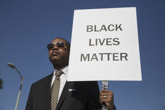 Los Angeles, California, USA, January 19, 2015, 30th annual Martin Luther King Jr. Kingdom Day Parade, black man hold sign Black L Stock Image