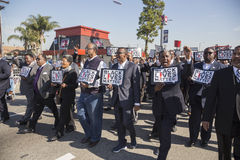 Los Angeles, California, USA, January 19, 2015, 30th annual Martin Luther King Jr. Kingdom Day Parade, men hold signs Black Lives. Matter Stock Photo