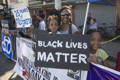 Los Angeles, California, USA, January 19, 2015, 30th annual Martin Luther King Jr. Kingdom Day Parade, women hold sign Black Lives Royalty Free Stock Photos