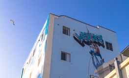 Street art on Venice Beach, Los Angeles. Colorful building with graffiti on blue sky background. Los Angeles, California, USA - June 11, 2017: Colorful buildings royalty free stock photography