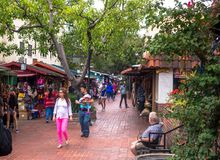 Olvera Street. Historic Tourist Attraction Los Angeles, USA. Los Angeles, California, USA - June 12, 2017: Tourists walking among the colorful shopping souvenir Royalty Free Stock Image