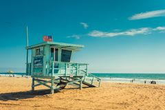 Los Angeles/California/USA - 07.22.2013: Lifeguard tower on the beach. Lifeguard tower on the beach, people in the background swimming in the ocean and laying Stock Photography