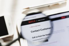 Los Angeles, California, USA - 6 March 2019: Netflix, NFLX official website homepage under magnifying glass. Concept. Los Angeles, California, USA - 6 March 2019 royalty free stock images