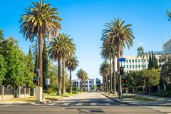 Urban life in Los Angeles. Streets of the big city. Los Angeles, California, USA - March 21, 2017: Palms and streets of Los Angeles. Urban life in Pasadena Stock Photography