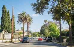 Streets of Los Angeles. Modern street in the residential area of Melrose. Los Angeles, California, USA - March 21, 2017: Palms and streets of Los Angeles. Urban Stock Images