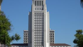 Los Angeles City Hall Building Tilt-up During the Day. The Los Angeles City Hall building is shown in a tilt-up view from downtown L.A.`s Grand Park during a stock video
