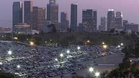 Los Angeles City Skyline with Dodger Stadium Parking Lot. stock footage