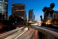 Los Angeles city skyline and freeway Stock Photos