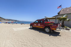 Los Angeles County Lifeguard Truck in Malibu California. Malibu, California, USA - August 15, 2015:  Los Angeles County Lifeguard truck on the sand at Topanga Stock Photos