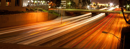 Los Angeles Downtown freeway at night. A scene of the freeway at night with the cars speeding on a busy night in downtown area Stock Photos