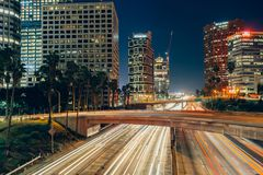 Los Angeles downtown at night. Office buildings and streets with light trails in Los Angeles downtown at night Royalty Free Stock Photos