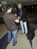 LOS ANGELES - FEBRUARY 6 : Actor Kevin Costner LAX. LOS ANGELES - FEBRUARY 6 : Actor Kevin Costner is seen signing a autograph as he makes his way thru LAX (Los Stock Photos