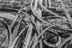 Los Angeles Freeway Interchange Ramps Aerial Black and white. Aerial of the Harbor 110 and Century 105 freeway interchange south of downtown Los Angeles in black Stock Photo