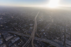 Los Angeles Freeway and Summer Smog Aerial. Aerial view of Santa Monica 10 freeway and summer afternoon smog near downtown Los Angeles, California Royalty Free Stock Images