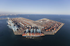Los Angeles Harbor Aerial. Los Angeles, California, USA - July 10, 2017:  Sprawling Los Angeles Harbor Pier 400 with Hyundai cargo ship unloading containers Stock Images