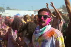People celebrate Holi Festival Of Colors Stock Images