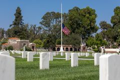Los Angeles National Cemetary flag lowered to half staff. LOS ANGELES, CA - SEPTEMBER 1, 2018: The Los Angeles National Cemetery lowered the flag to half staff royalty free stock photos