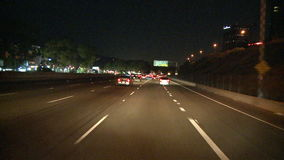 Los angeles night highway driving stock video footage