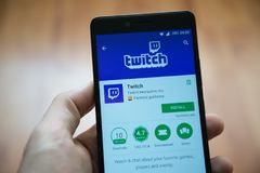 Twitch application in google play store. Los Angeles, november 2, 2017: Man hand holding smartphone with Twitch application in google play store Royalty Free Stock Photo