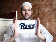 Los Angeles Rams american football team logo. Logo of Los Angeles Rams club on samsung tablet holded by arab muslim man. The Los Angeles Rams are a professional Stock Photo
