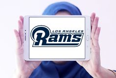 Los Angeles Rams american football team logo. Logo of Los Angeles Rams club on samsung tablet holded by arab muslim woman. The Los Angeles Rams are a Royalty Free Stock Photography