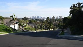 Los Angeles residential street with Downtown LA Skyline stock video footage