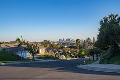 Los Angeles Residential Street with Downtown LA Skyline Royalty Free Stock Photo