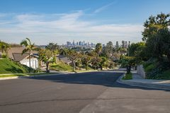 Los Angeles Residential Street with Downtown LA Skyline Royalty Free Stock Images