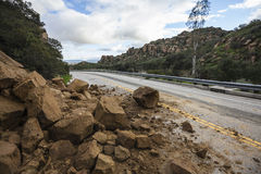 Los Angeles Rock Slide. Rock slide blocking Santa Susana Pass Road in the west San Fernando Valley area of Los Angeles, California Royalty Free Stock Images