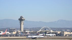 Airplane flying up and down of the busy Los Angeles International Airport