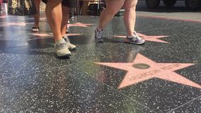 LOS ANGELES - September 2016: Hollywood Walk of Fame with people walking by. stock video footage