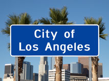 Los Angeles Sign. Los Angeles City Limit with towers and Palm Trees Stock Images